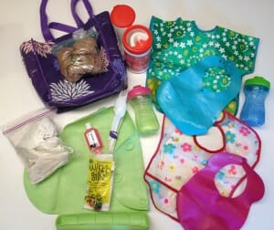 From bibs and placemats to sippy cups and wipes, this is all the stuff that lives in my eating-out bag.