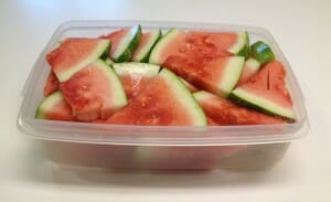 Cutting the whole watermelon into wedges makes it much more likely that we'll eat our fresh melon before it spoils in the back of the fridge, because it's easier to store wedges in a large plastic container.