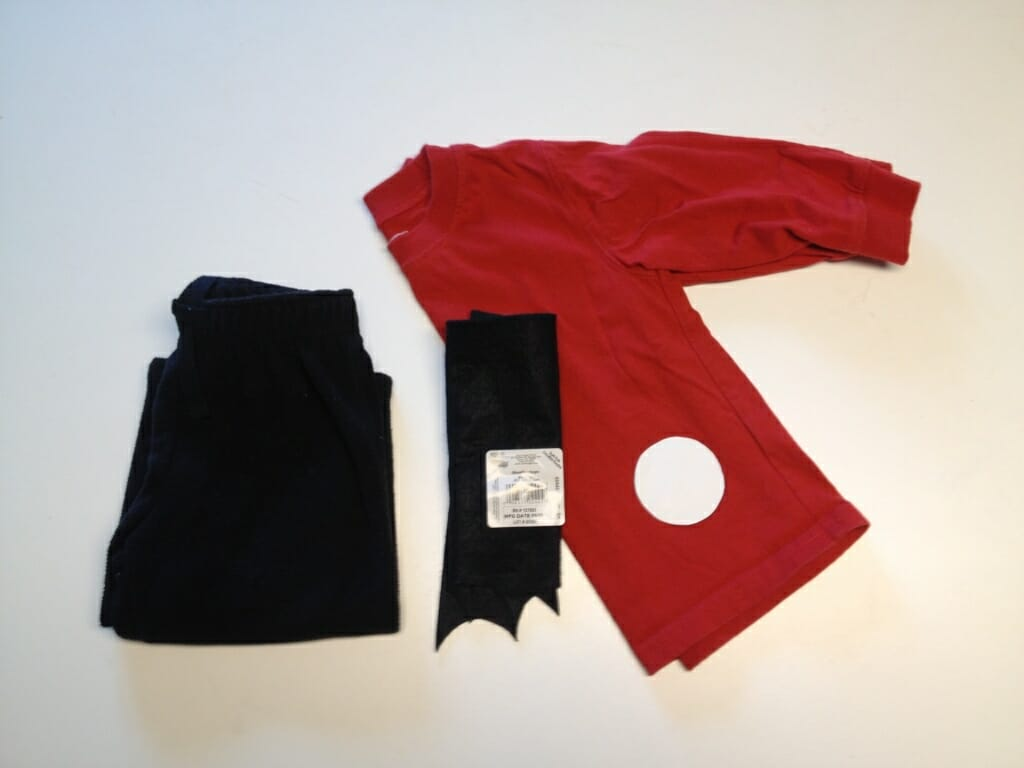 All you need to generate your very own ladybug costume for Halloween is a pair of black pants, a red top, some black felt or fabric, and a circle pattern. Make 18-24 circles and baste them on the top, and your costume is set. A black pipe-cleaner (for antennae) attached to a headband or (red or black hat) is a nice finishing touch.
