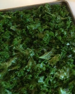 A batch of kale chips ready to go in the oven