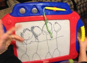 Kimmie's 2014 portrait of our family: left to right, Essie, Kimmie, me, and my dear husband