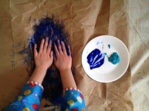 Kimmie fingerpainting