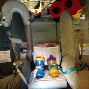 Neck pillows at the ready? Toys returned to a bin between carseats? Cups freshly filled and leashed? Yep, the backseat is ready to roll.