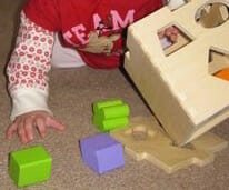 hard at work with shape-sorter