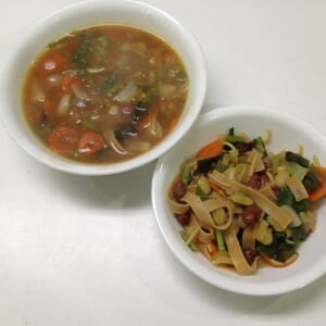 A bowl of grownup soup and a bowl of kiddo solids