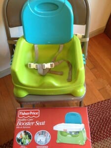 Our first booster seat for Kimmie, the Fisher-Price Booster Seat, began doubling as Essie's highchair as soon as Essie started solids.