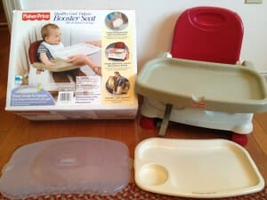 The deluxe model of the basic Fisher-Price seat costs only about $5 more, but comes with a detachable tray liner and cover, is height-adjustable, and takes up slightly less space in one's suitcase.