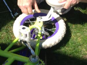 removing Essie's training wheels