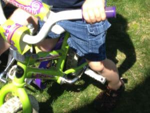 straddling bike with feet on ground