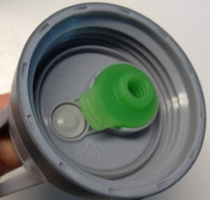 If that green part isn't properly inserted into the lid, your Camelbak water bottlewill leak all over.