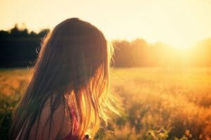 girl outdoors at sunset