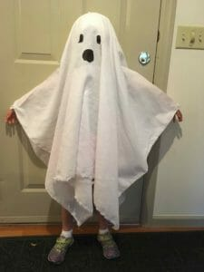 Kimmie, wearing her finished ghost costume, demonstrates why the wrist straps are especially useful.
