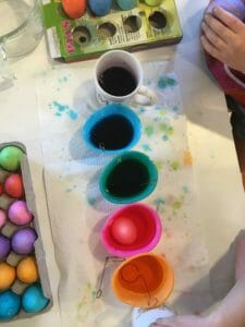 dyeing Easter eggs with kids is messy