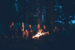 older kids enjoying a campfire at camp