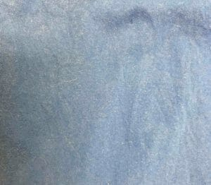Kimmie's new shirt after #8 - crayon gone, but blue noticeably lighter around the stain